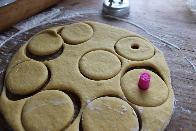 roll the dough and cut circles. I used a marker lid to cut the holes!