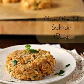 one oven roasted salmon cake on a white plate