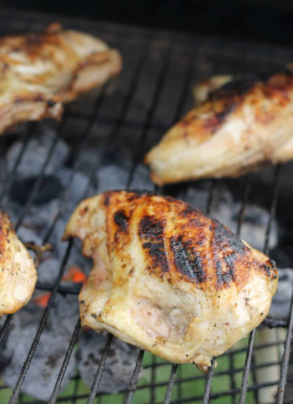 four chicken breasts on the grill