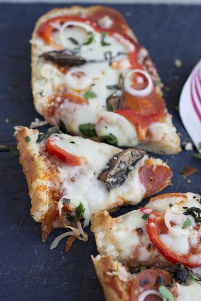 French bread pizza is a simple way to deliver dinner in just minutes. It's one of my favorite crusts to use and it's easy to customize toppings for everyone