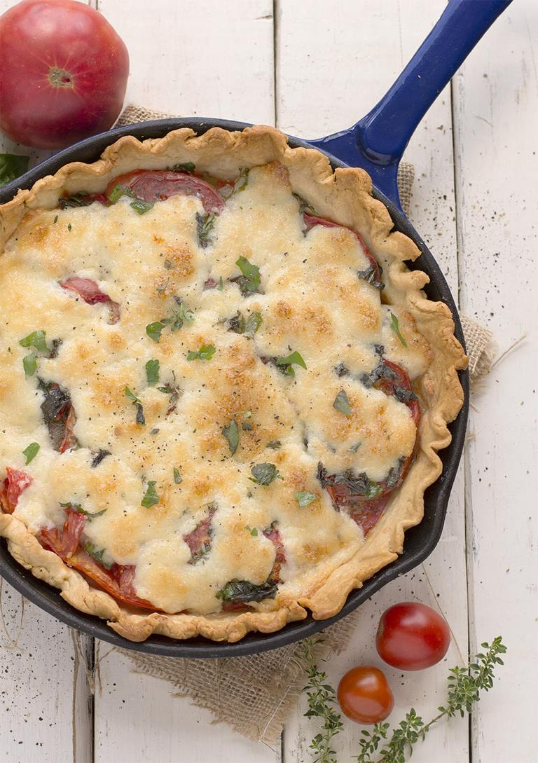 What is an easy tomato pie? One clue: it's not a pizza. It's summer. In a pan. Baked in the oven. It's summer love.