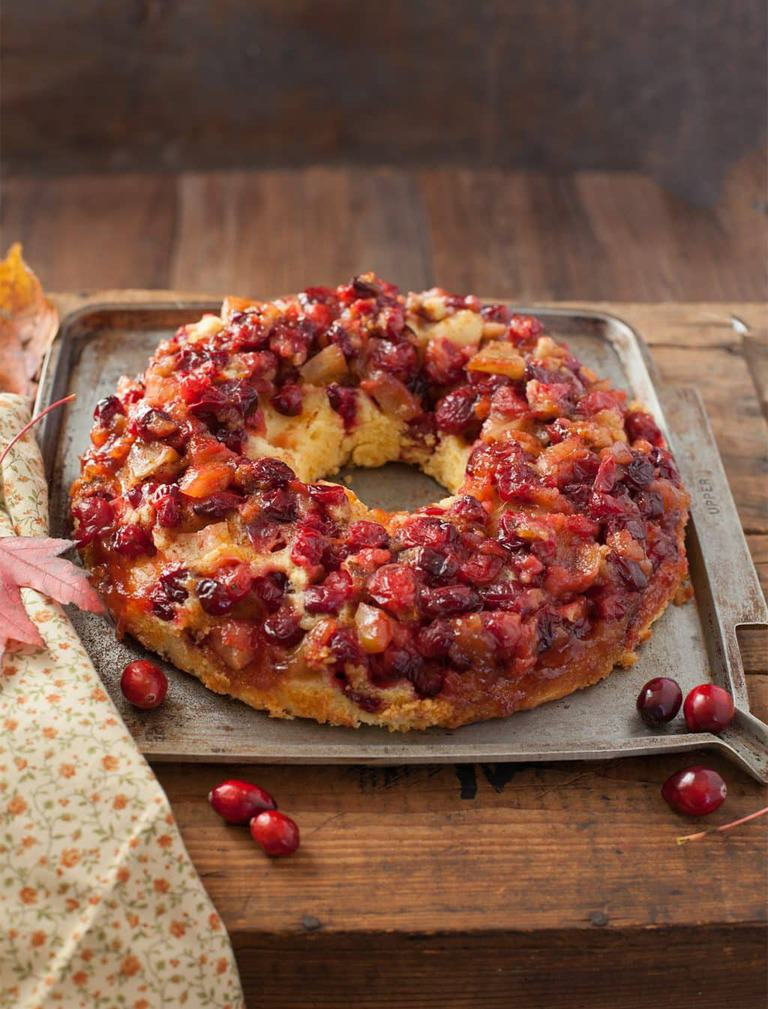 Easy cranberry apple cake is a blend of tangy-tart richness. Think cobbler meets pound cake. Perfect for your holiday baking!