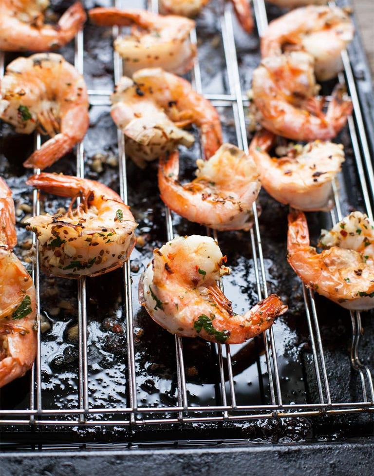 Looking for just the right savory-spicy appetizer for your next get together or just something different for dinner? My easy roasted garlic shrimp are jam-packed with big flavors and only take 20 minutes to make including cook time.