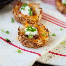 Loaded hash brown potato skins take away all the messy baking, scraping and remaking of a traditional potato skin and make it simple, affordable and tasty!