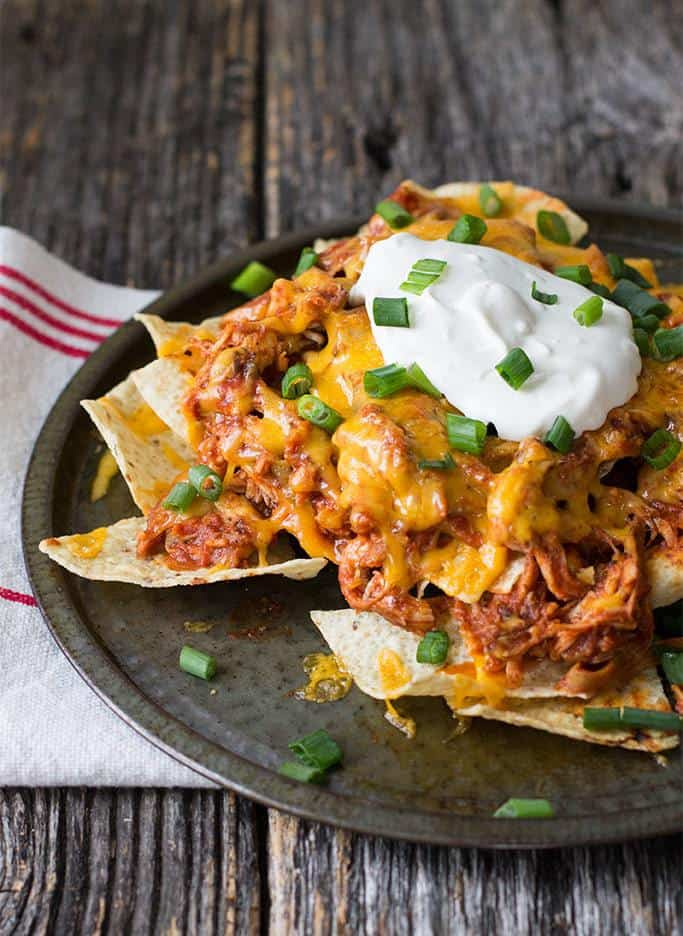 Chicken nachos are a great way to spice up your old favorite. Simple ingredients turn into something amazing that you can have on the table in 25 minutes--great for dinner or game day snacking for a crowd.