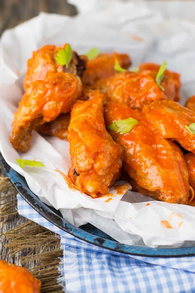 They take some time to make, but crispy baked wings right from your oven and smothered in some zesty buffalo sauce is a great way to feed yourself or a crowd!