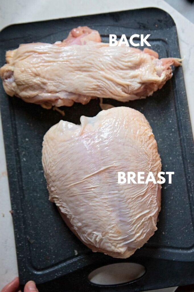 the separated back and breast of a whole chicken