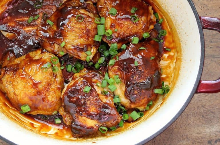 garlic and ginger chicken thighs in a dutch oven