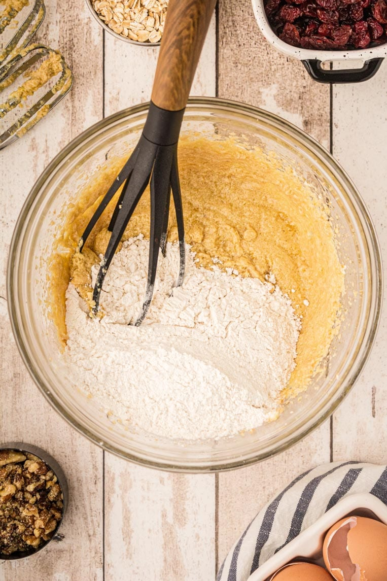 The bowl of eggs and butter with the flour added getting ready to be mixed.