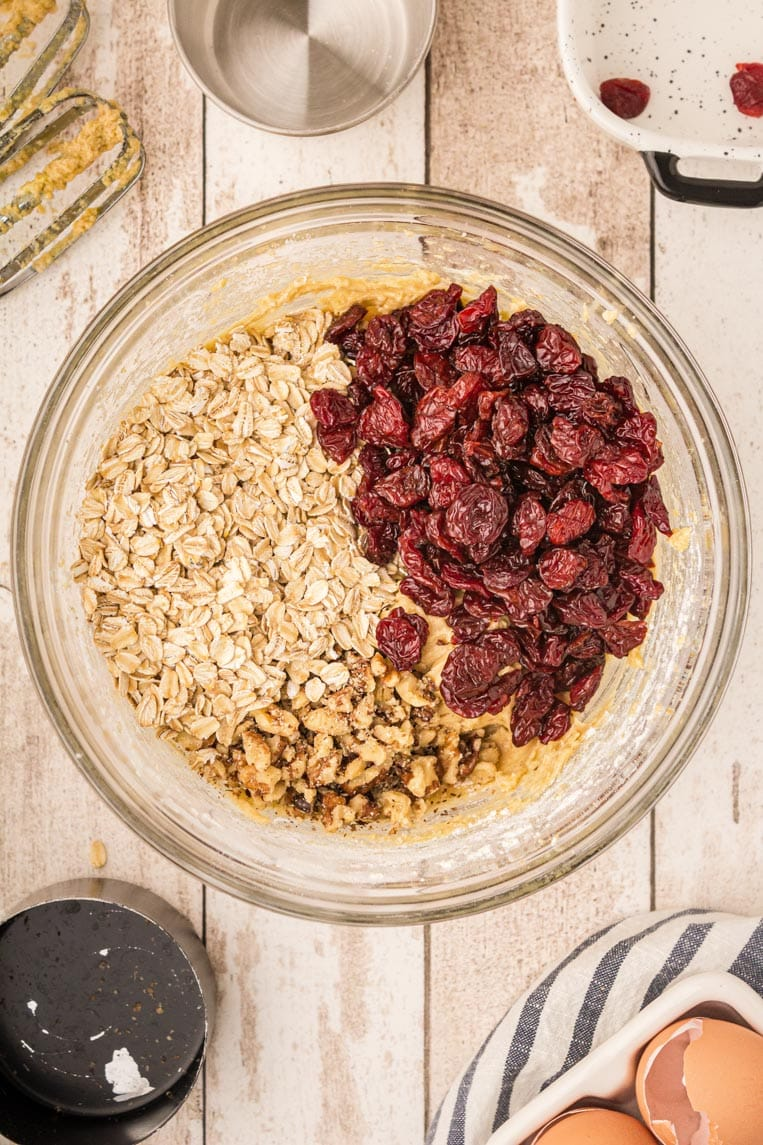 Mixed batter with nuts, fruit, oats getting ready to be folded in.