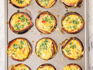 A 12 cup muffin tin with baked egg muffin cups.
