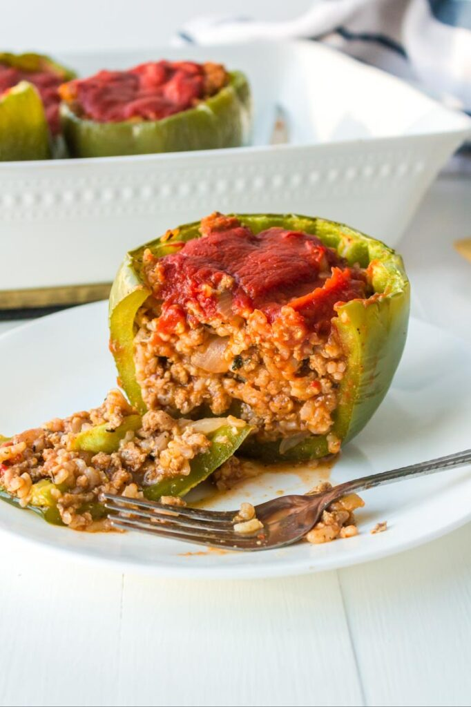 a stuffed pepper sliced open to show the filling