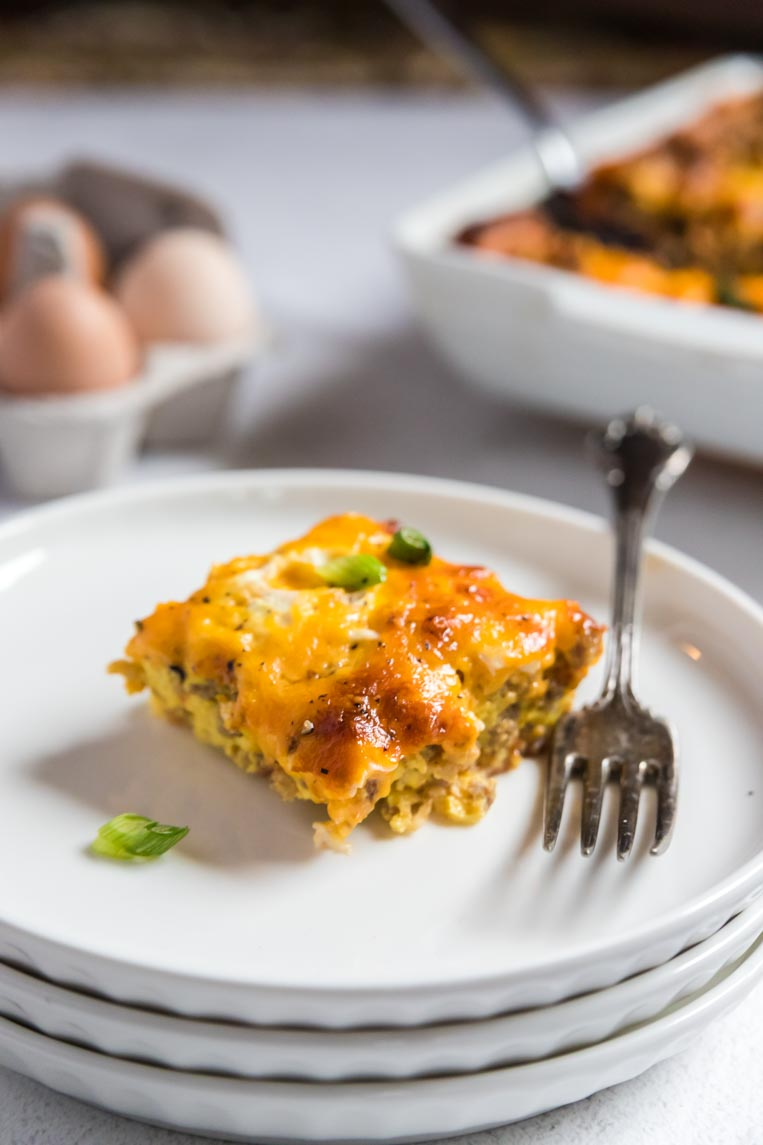 a slice of breakfast casserole on a stack of plates