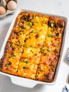 a pan of breakfast casserole on a table sliced but not eaten yet