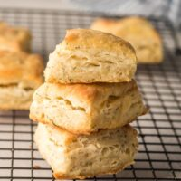 three biscuits stacked on a cooling rack