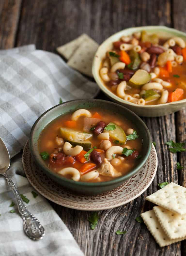 minestrone soup with chicken in a bowl on a table