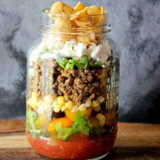 a jar of taco salad in a jar on a table