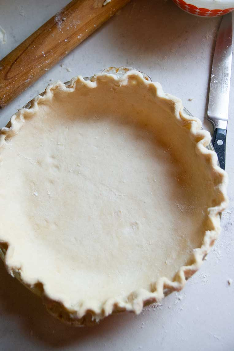 a pie shell with crust in it ready to be baked