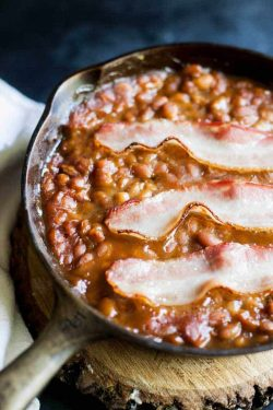 Canned baked beans get a simple flavor boost from their original so no one will know you didn't make them from scratch.