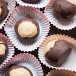 buckeye balls with peanut butter and chocolate in miniature cups