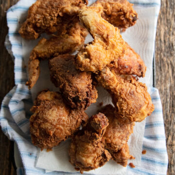 A platter of buttermilk fried chicken on a table.