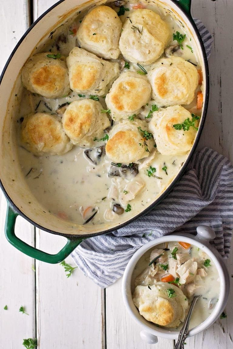 One pan, ultra cozy creamy chicken and soft biscuits you can enjoy any night of the week. Make ahead friendly too!