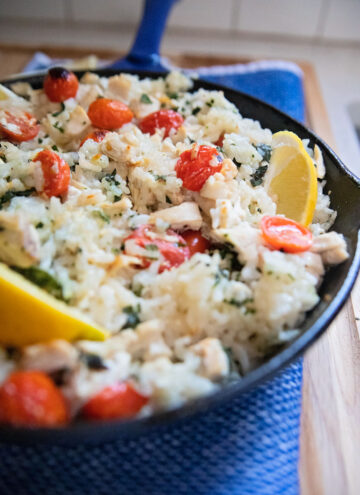 a skillet of finished oven chicken risotto
