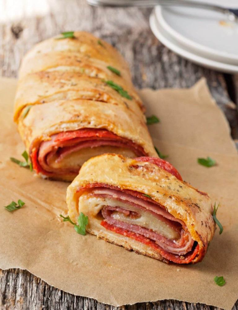 a slice of stromboli on parchment paper
