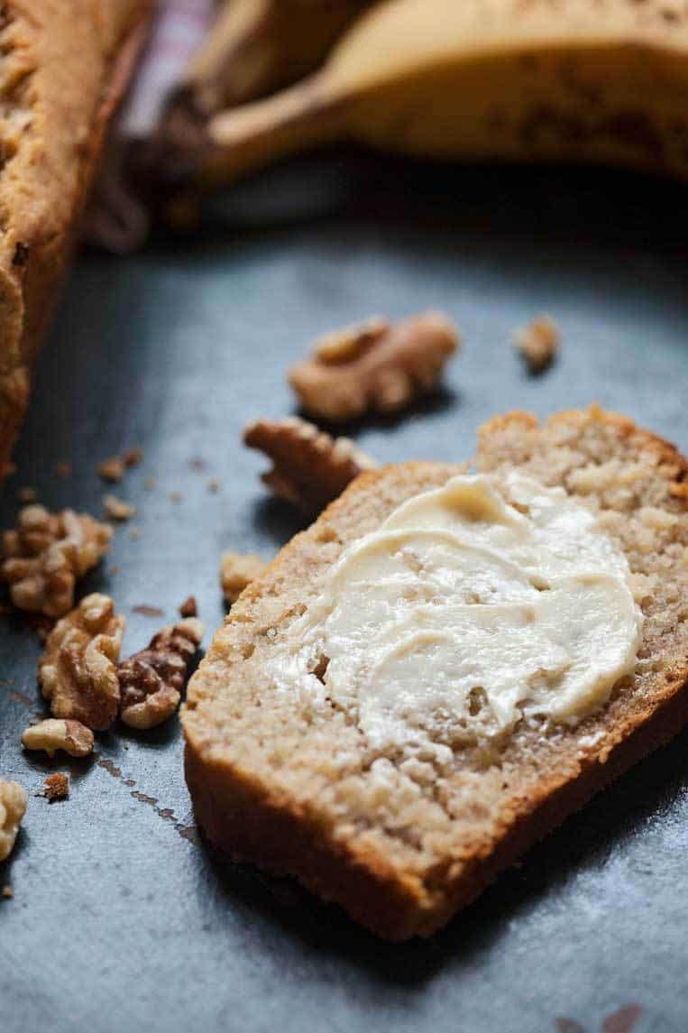 easy gluten free banana bread sliced and spread with butter