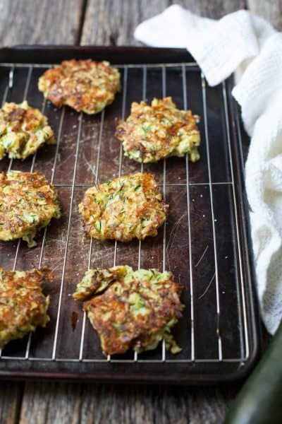 Fried zucchini cakes are the perfect way to use up this versatile vegetable and they're freezer friendly too!
