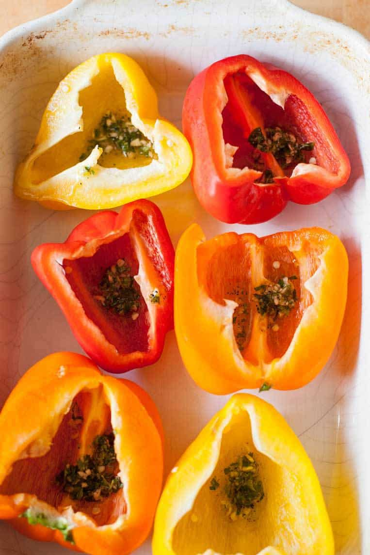 stuffed bell peppers cut in half and rubbed with garlic, oregano and olive oil before baking
