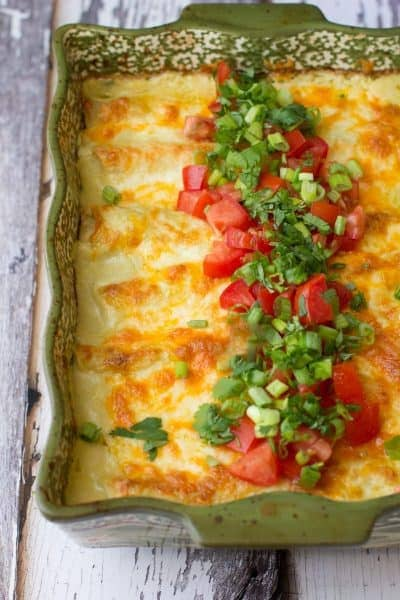 30-minute green chile chicken enchiladas can be made ahead if you're in a pinch and make a perfect weeknight dinner option.