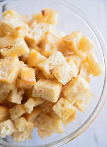 a bowl of golden brown croutons in a bowl