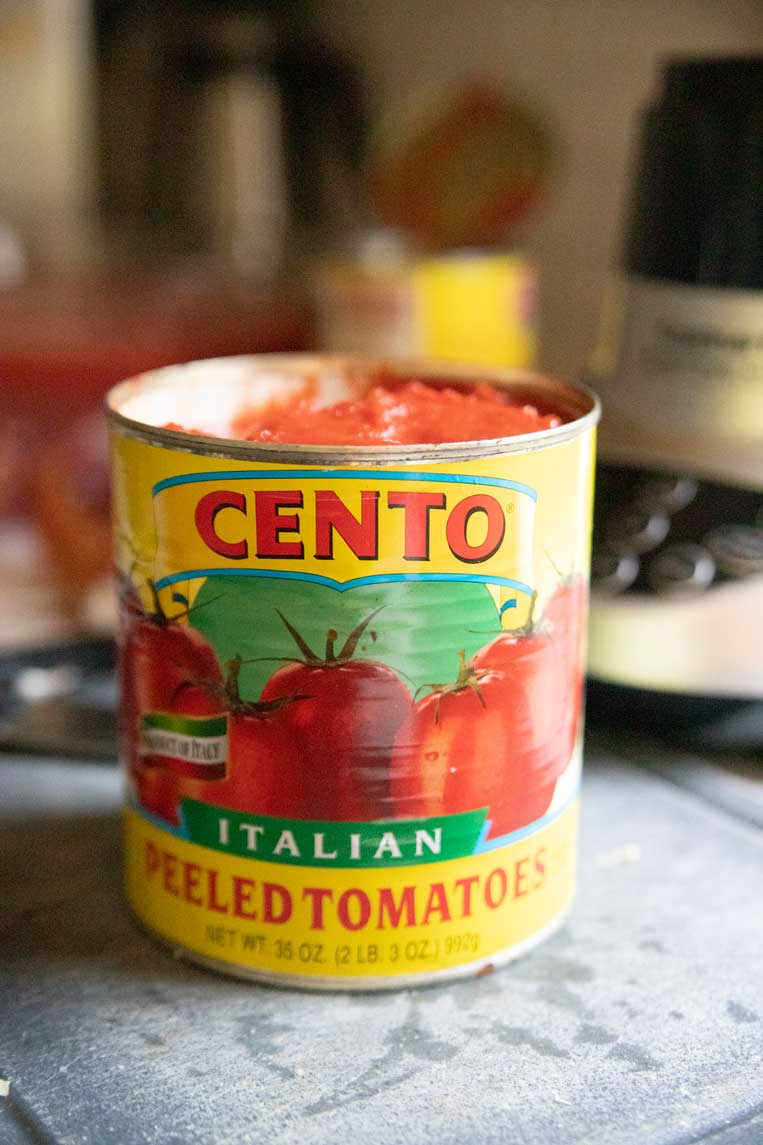 a can of whole tomatoes on a counter