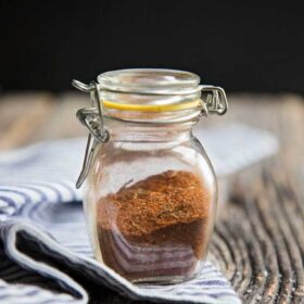 Homemade taco seasoning in a glass jar ready to be added to your ground beef.
