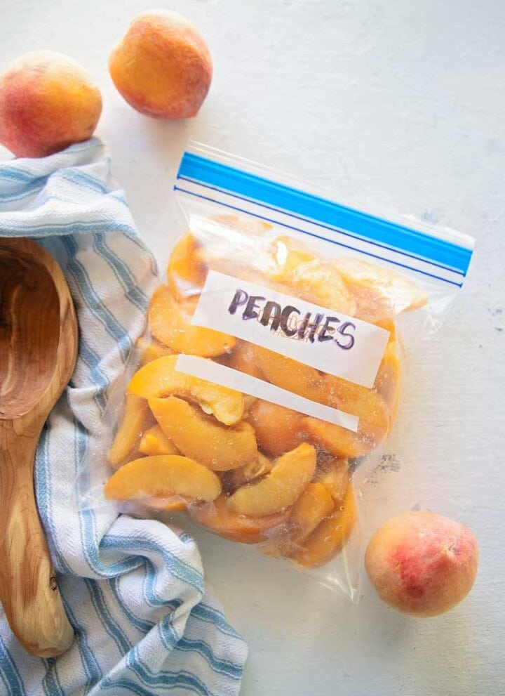 a freezer bag of peaches on a table