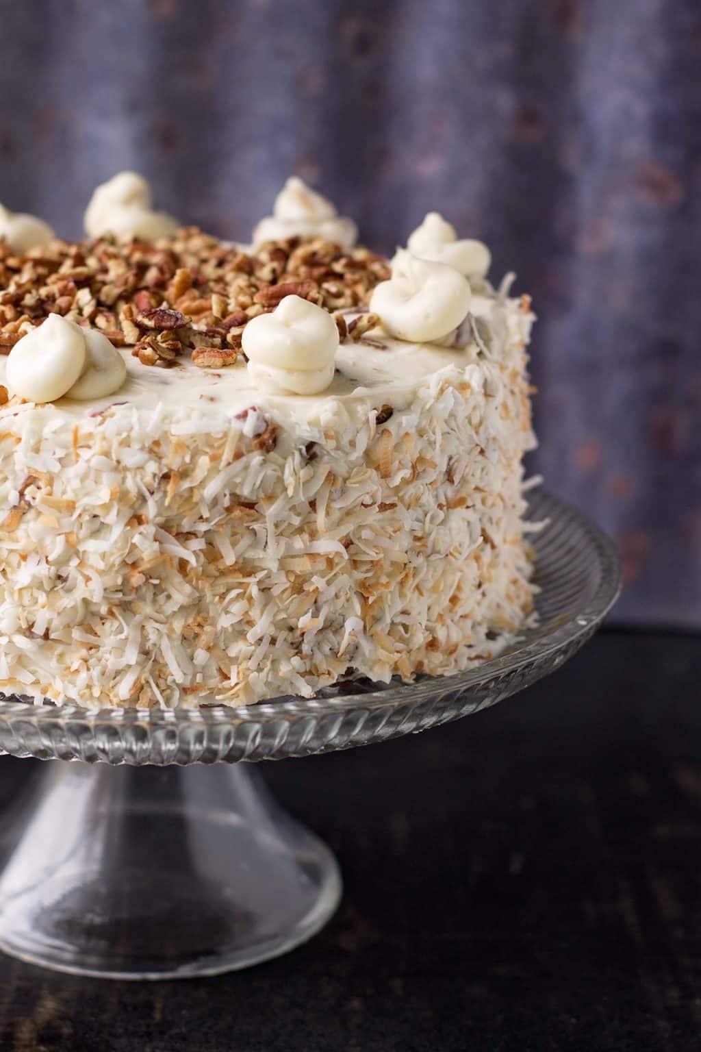 italian cream cake on a glass cake plate