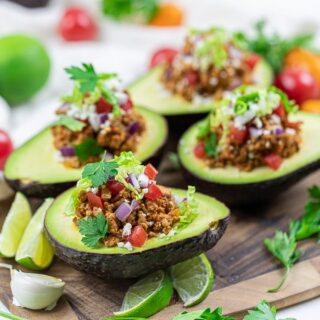 avocados with taco filling on a cutting board
