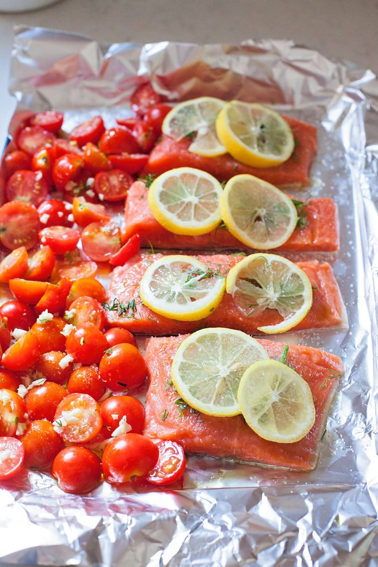 layer lemons on good quality salmon filets and lay the tomatoes beside the fish