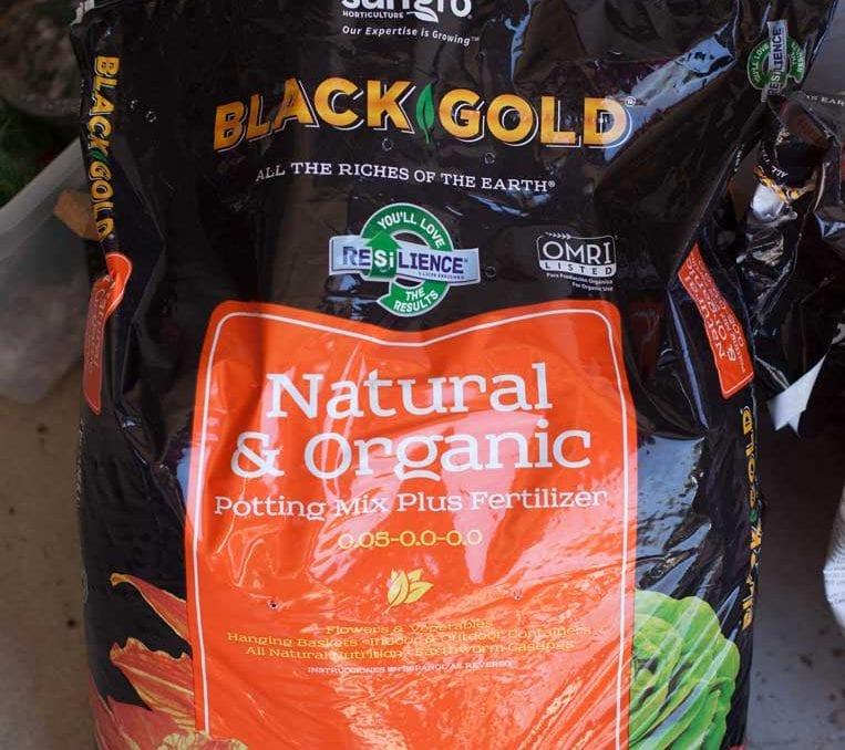 a bag of black gold organic potting mix