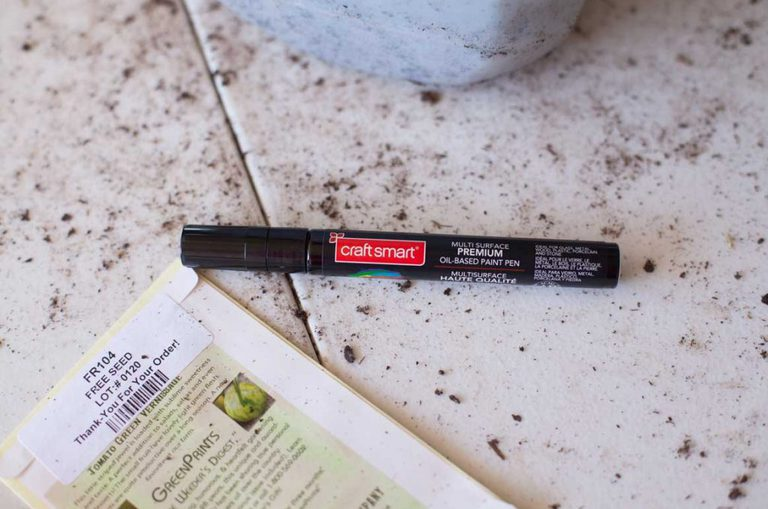 a black craftsmart paint pen on a table