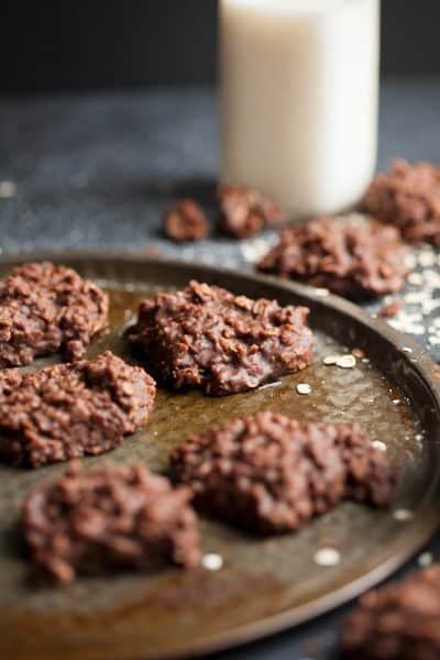 no bake cookies on a table with a big glass of milk