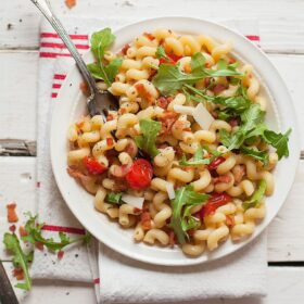 BLT pasta salad takes just minutes to make and brings in the bold flavors of sautéed tomatoes, bacon and greens. This is a perfect weeknight dinner all in one pan or filling side dish.