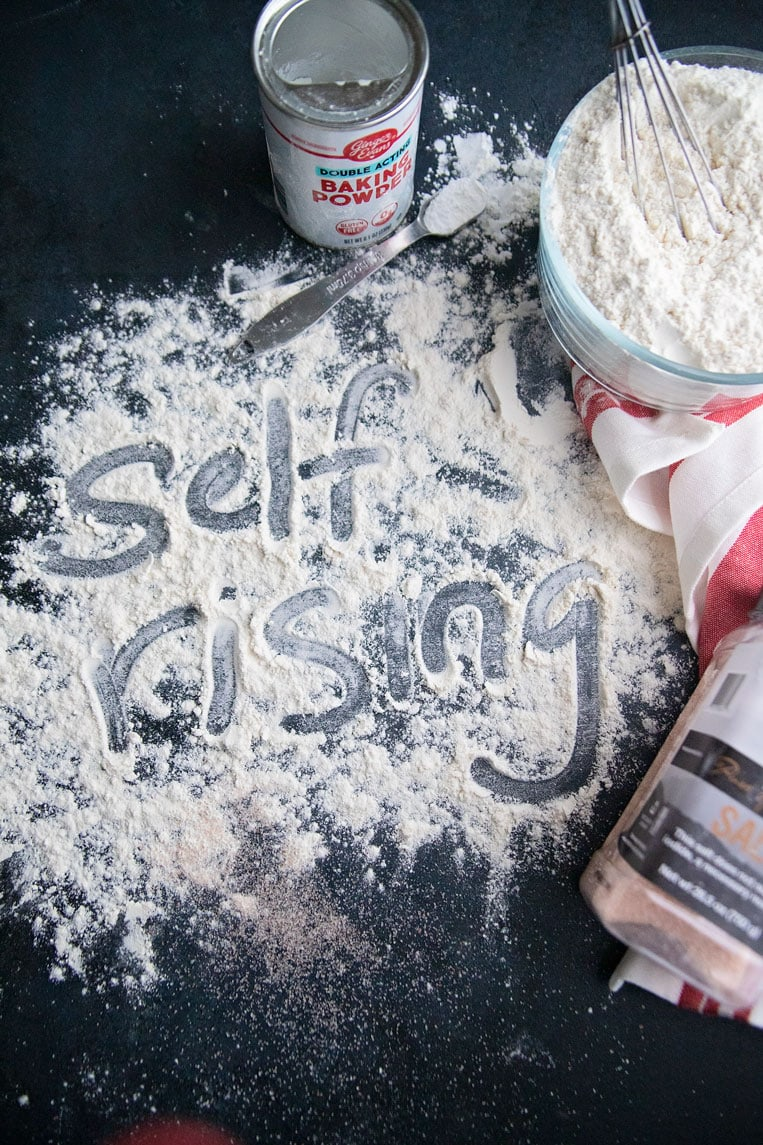the word self rising written in flour on a board