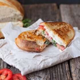 It's all that is tasty about spring rolled up in a gooey, cheesy, melty hot sandwich. Caprese grilled cheese is just the way to do it.
