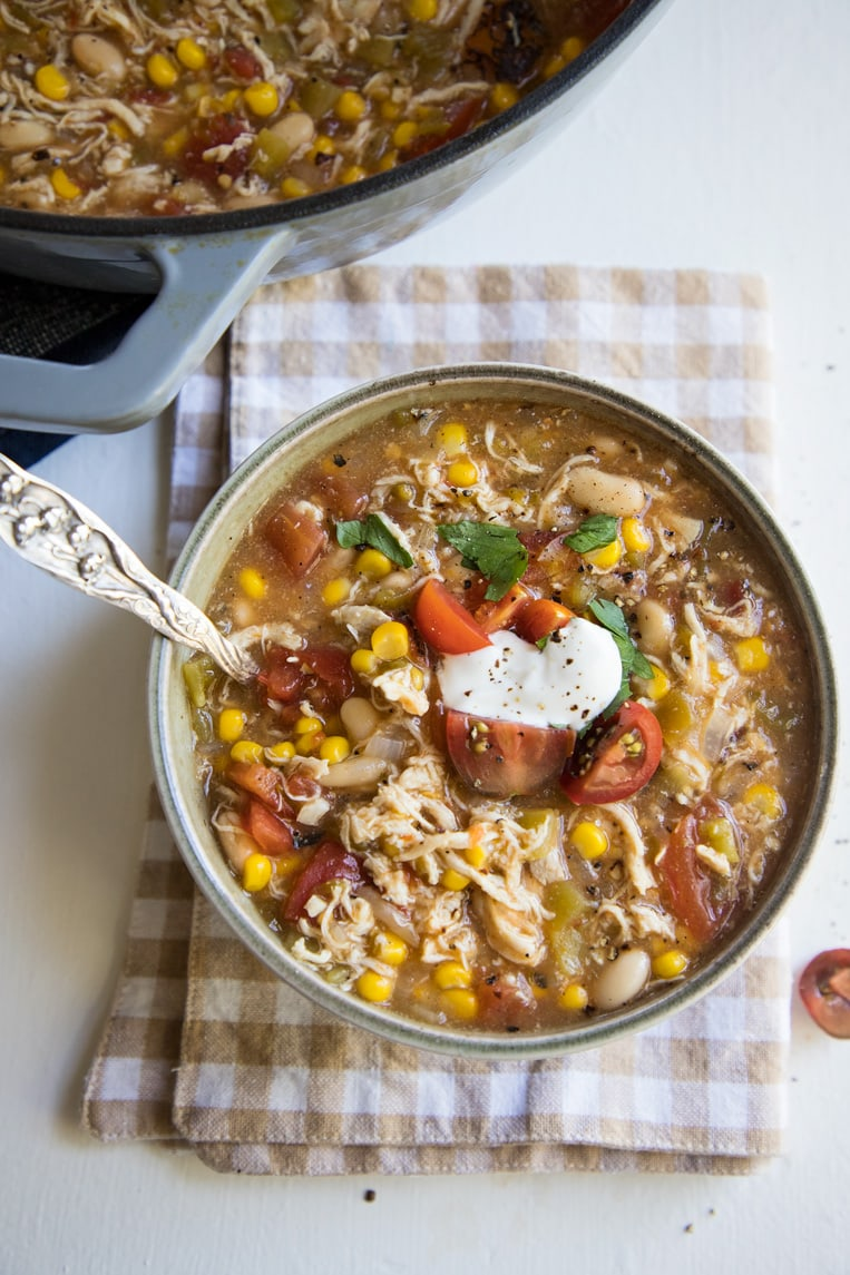 a bowl of white bean chicken chili with a spoon