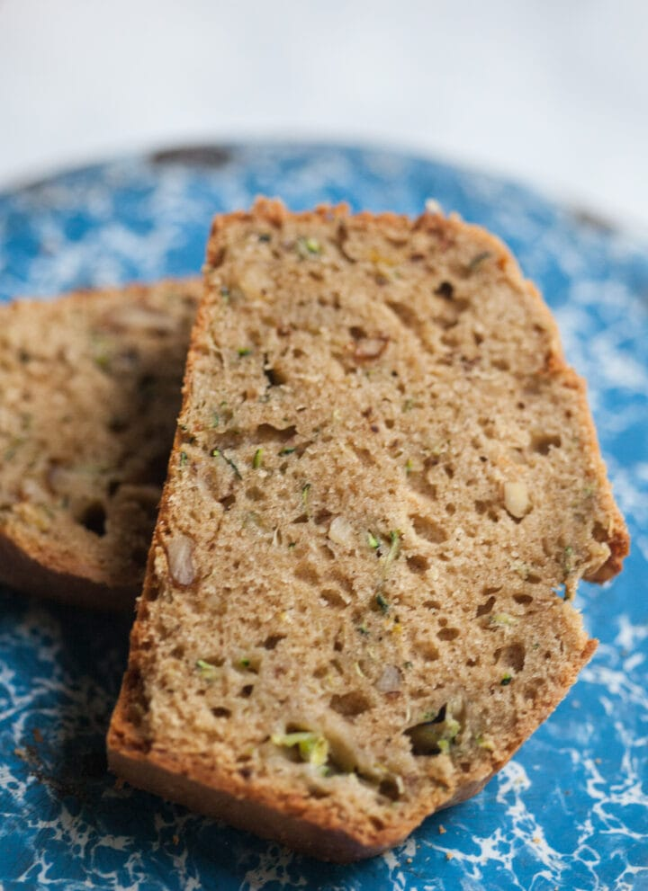 a slice of zucchini bread on a blue plate